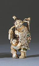POLYCHROME IVORY NETSUKE Depicting a sage and young child. Height 2.25