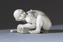 IVORY NETSUKE In the form of a kneeling rat catcher with escaping rat. Signed