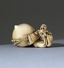 IVORY NETSUKE In the form of Fukurokuju laughing while sitting beside a giant peach. Marked with Koku seal. Length 2