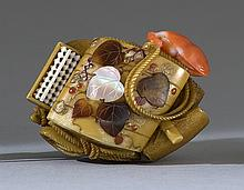 SHIBAYAMA-INLAID IVORY NETSUKE By Shubi. In the form of an inro, tobacco pouch, bean-form netsuke, abacus, sandal, yatate, and other...