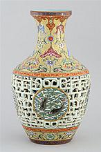 UNUSUAL DOUBLE-WALLED PORCELAIN VASE With polychrome fish medallions on open lattice ground. Famille jaune banding at foot and shoul...