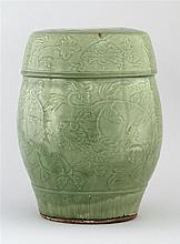 CELADON STONEWARE GARDEN BARREL In drum form with carved floral design and faux cover embellishment. Height 15.5