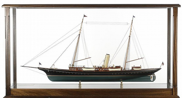 CASED MODEL OF THE STEAM YACHT CORSAIR With raised panel cabins and bulwarks. Free standing mahogany case with stand. Case height 52...
