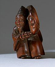 WOOD NETSUKE By Tomomasa. Depicting a Sambaso dancer with a rattle. Signed. Height 2