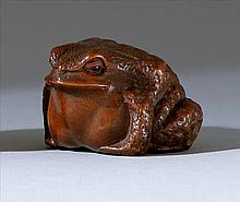 WOOD NETSUKE By Iseyamada Masanao. In the form of a crouching frog with inlaid eyes. Signed. Length 1.6