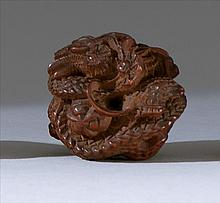 WOOD NETSUKE In the form of a coiled dragon. Diameter 1.5