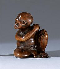 WOOD NETSUKE By Shigekazu. In the form of a seated man attacked by a large wasp. Signed. Height 1.5