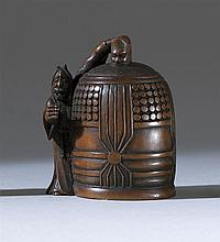 WOOD NETSUKE By Masamin. In the form of Kiyohime beside a large bell. Height 2