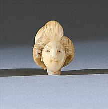 IVORY OJIME In the form of a woman's head with elaborate coiffeur. Length .65