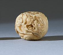 IVORY OJIME By Tomomasa. In ball form depicting a dragon and pearl. Diameter .75