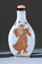 PORCELAIN SNUFF BOTTLE In pear shape. With salmon-red and gilt design of Zhongkui. Height 2.7