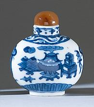 BLUE AND WHITE PORCELAIN SNUFF BOTTLE In ovoid form with decoration of scholar's objects. Four-character Qianlong mark on base. Heig...