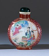 FAMILLE ROSE PORCELAIN SNUFF BOTTLE In flattened ovoid form with figural cartouches on a cracked-ice ground. Height 2.2