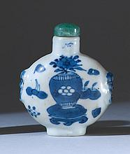 BLUE AND WHITE PORCELAIN SNUFF BOTTLE In ovoid form with decoration of scholar's items. Four-character Qianlong mark on base. Height...