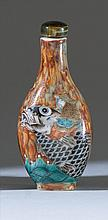 POLYCHROME PORCELAIN SNUFF BOTTLE In teardrop form with depiction of a sage riding on a large carp. Four-character Qianlong mark on...