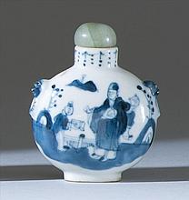 BLUE AND WHITE PORCELAIN SNUFF BOTTLE In ovoid form with mask and mock-ring handles. Body decorated with figural landscape. Four-cha...