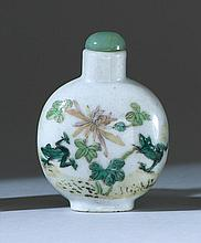 PORCELAIN SNUFF BOTTLE In ovoid form with frog and lotus design. Four-character mark on base. Height 2.25