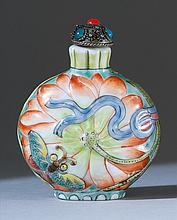 MOLDED PORCELAIN SNUFF BOTTLE In ovoid form with lotus and butterfly design. Four-character Guangxu mark on base. Height 2.2