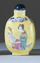 POLYCHROME PORCELAIN SNUFF BOTTLE In elongated ovoid form with depiction of ladies and a crane, all on a yellow ground. Height 2.3