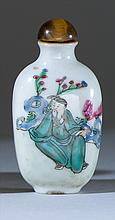 PORCELAIN SNUFF BOTTLE In spade shape depicting a sage in a rockery landscape. Seal mark on base. Height 2.3