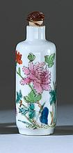 POLYCHROME PORCELAIN SNUFF BOTTLE In cylinder form with floral design. Height 3