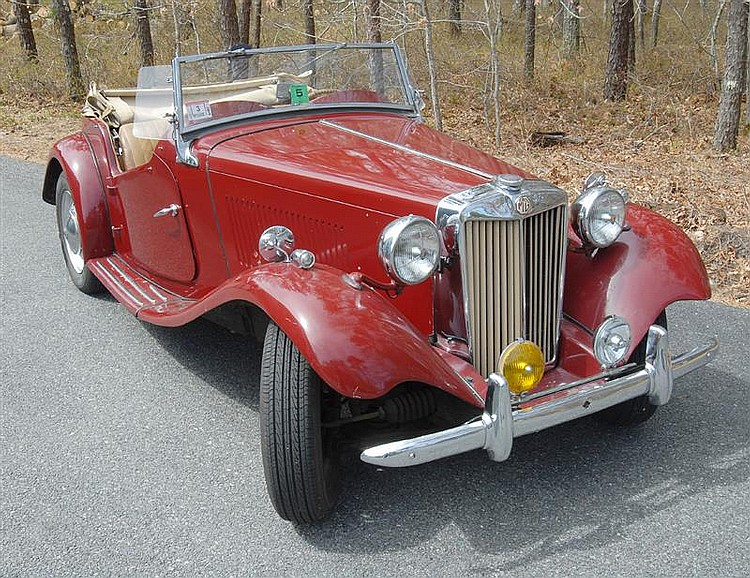 1950 MGTD CONVERTIBLE SPORTS CAR Four-speed transmission. Two seater. Original maroon paint job and tan leather interior. Recently i...