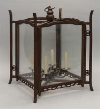 HONGMU LANTERN In rectangular form with four-socle brass fixture. Apron with openwork carving. Height 21.5