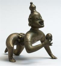 INDIAN GILT-BRONZE FIGURE Krishna as the Butter Thief. Height 3.25