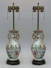 PAIR OF FAMILLE ROSE MANDARIN-PATTERN VASES In baluster form with gilt handles. Heights of vases 12