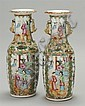 PAIR OF CHINESE EXPORT ROSE MEDALLION PORCELAIN VASES With relief gilt foo dog and dragon handles. Height 11½