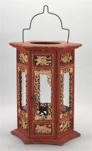 RED AND GILTWOOD LANTERN In hexagonal form with pierced foliate carving. Height 17