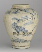 KOREAN UNDERGLAZE BLUE PORCELAIN JAR In inverted pear shape with bird, tiger, and pine tree design. Height 16.25