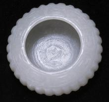 CELADON JADE WRITER'S COUPE In squat ovoid form with melon ribbing. Diameter 2.2
