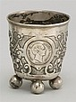 CONTINENTAL SILVER FOOTED CUP Chased fruit and scroll designs. Ball feet. Marked