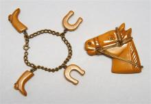 EQUESTRIAN-THEME BAKELITE BROOCH AND BRACELET Brooch formed as a horse's head with metal harness. Height 1.37