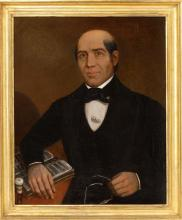 FRAMED PORTRAIT OF A SEATED GENTLEMAN A middle-aged man seated with his right hand clutching a pair of spectacles and his left arm r...