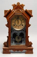 GILBERT SHELF CLOCK In pine. Etched glass case door depicts urns of flowers. Height 19.25