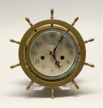 WATERBURY BRASS SHIP'S CLOCK In the form of a ship's wheel. Face diameter 4