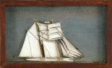 FRAMED SHADOW BOX MODEL OF A SHIP A white-hulled brigantine at sea. Overall 12.5