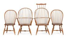 FOUR WINDSOR-STYLE CHAIRS Two bowback side chairs, a sack-back armchair and a comb-back armchair, all in maple. Presumably by the sa...
