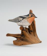 CONTEMPORARY DECORATIVE CARVING OF A SONGBIRD Stamped on underside
