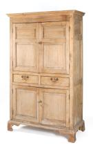 ANTIQUE ENGLISH CUPBOARD In pine with molded cornice. Two paneled doors above two short drawers above two paneled doors. Bracket bas...