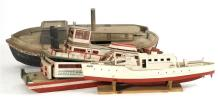 FOUR LARGE WOODEN BOAT MODELS Two paddle-wheelers, a workboat and a vessel with white hull. Approximate length of largest 66