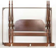 SHERATON-STYLE TESTER BED In mahogany with foliate-carved columns sans finials. Includes rails and tester frame. Height 79