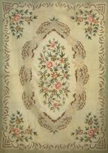 HOOKED RUG Mid-20th Century Central arrangement of flowering branches in greens, brown, dark gold, pink and peach surrounded by brow...