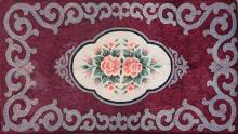 HOOKED RUG Four-lobed central medallion of light gray outlined in black and gray contains a bouquet of pink roses and green leaves....
