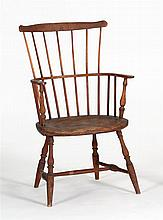ANTIQUE AMERICAN WINDSOR FAN-BACK ARMCHAIR In oak and ash with pine seat.