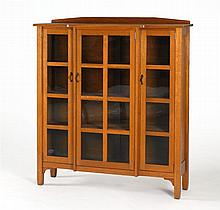 MISSION OAK THREE-DOOR BREAK-FRONT CABINET By Quaint Furniture Co. of Grand Rapids, Michigan. Includes three original adjustable she...
