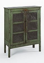 ANTIQUE AMERICAN PIE SAFE In pine and other woods under apple green paint. Two doors with pierced tin panels with geometric designs....
