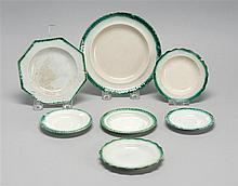 SEVEN LEEDS SOFT PASTE ITEMS Five cup plates and two small plates, all with green molded borders. Diameters from 3.5